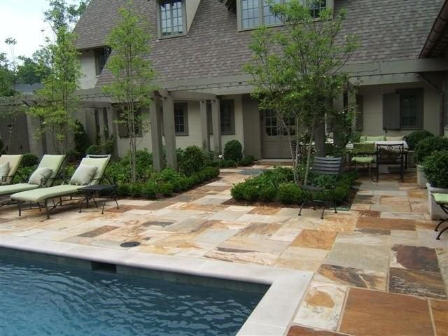 variegated cut flagstone pool deck with indiana limestone coping