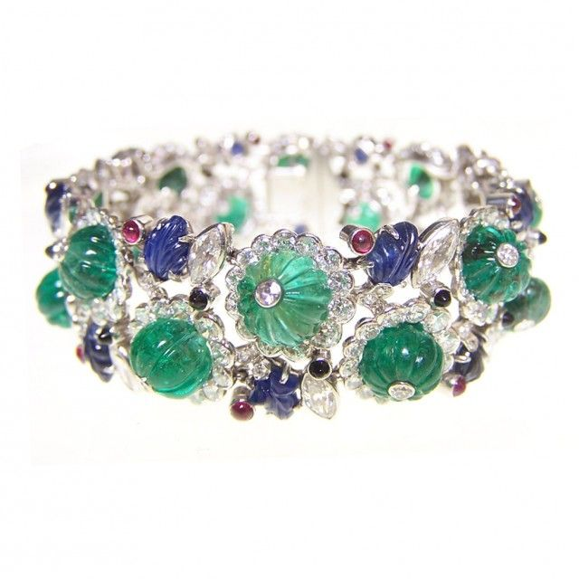 Parisian jeweler Henri Picq did a lot of work for Cartier, and he was renowned both for his platinum jewelry as well as his Tutti Frutti pieces. He created this bracelet, which scatters large carved emeralds and sapphires among diamonds and tiny cabochon rubies and onyx. Circa 1925.    [quoted from thehairpin]