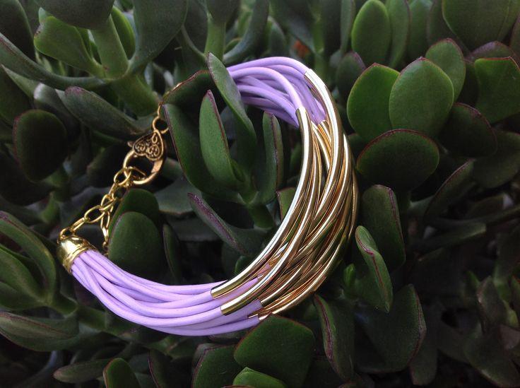 Purple Indian Leather with gold tube beads.