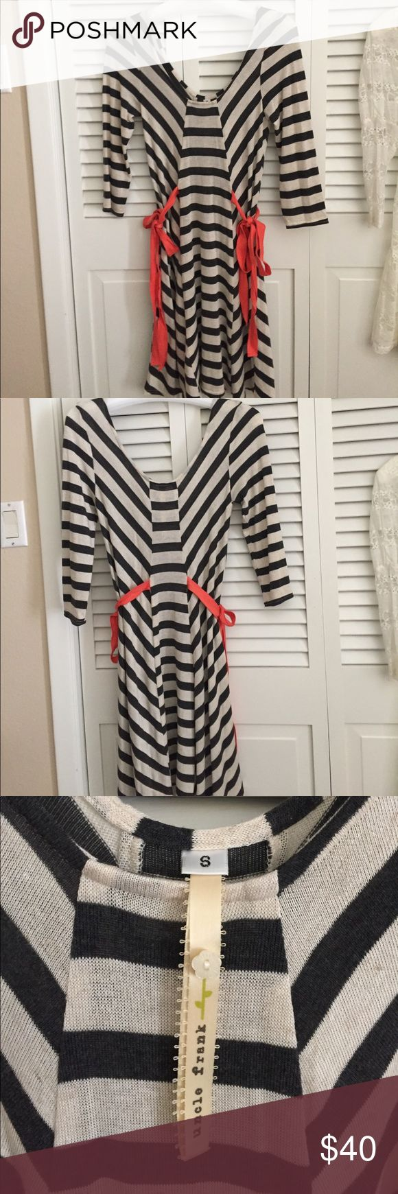 Ladies dress This an uncle frank striped dress with orange cotton ties on each side. I wore it with a cream t shirt underneath. It is polyester, rayon, linen, and spandex. It is in new condition. Three quarter sleeves. uncle frank Dresses