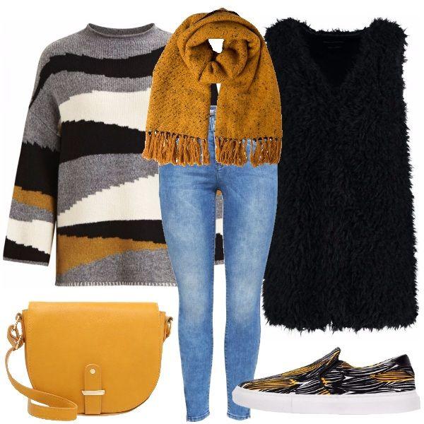 Outfit per tutti i giorni, in cui grazie ad una bella giornata di sole possiamo permetterci come capospalla, il gilet di pelliccia ecologica. Il look è composto da un jeans skinny, un maglione in fantasia grigio nero e bianco con un tocco giallo, fantasia ripresa dalle slip on. A completare la tracolla gialla.