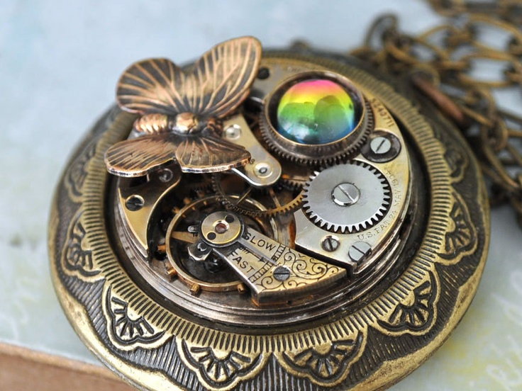 EHCHANTED antique brass steampunk watch movement container locket necklace. $76.50, via Etsy.