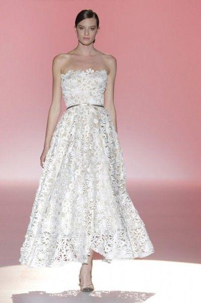 Eleganti abiti da sposa realizzati con preziosi tessuti nei toni del rosa o total white per la nuova collezione sposa 2015 di Hannibal Laguna