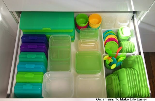 Divide a deep drawer into  categories to make lunch containers easy to find and keep organised