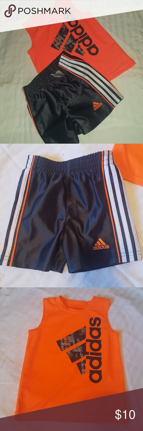 Adidas baby Blaze Orange and gray shorts outfit. I bought this last fall and my son was too big for it by the time hot weather came to Minnesota.  This outfit has zero flaws so it is basically new without tags. adidas Matching Sets