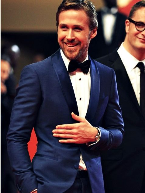 Only he can pull of a suit like that