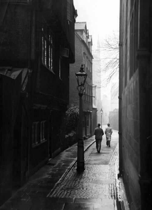 Students walking along Magpie Lane at Oxford University. Photograph by William Vandivert. Oxford, England, 1939.