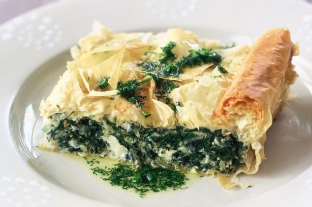 Spanakopita is a traditional spinach or silver beet pie with cheese and herbs, enveloped by crispy, flaky filo pastry.