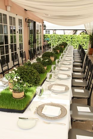 In September, Los Angeles floral designer Eric Buterbaugh set topiary  balls on beds of wheatgrass at the...