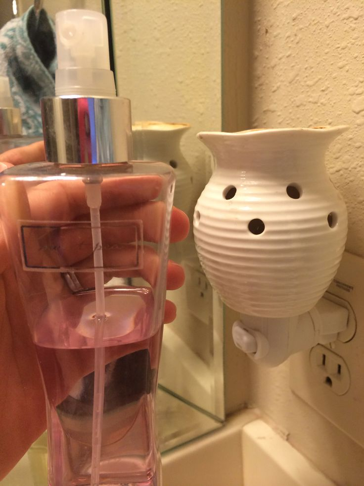 Scentsy/Bath & Body Works Wallflower Hack (Use Body Spray!)  1. Find your partially-used body mists or sprays. 2. Pour into Scentsy wax warmer dish.   For Wallflower: 1. Twist the empty glass fragrance bulb out of the plug-in. 2. Using a butter knife, pry open the plastic stopper from the fragrance bulb. The stopper holds an absorbent stick that draws the fragrance upward. 3. Pour in body spray. 4. Pop plastic stopper back onto fragrance bulb. 5. Screw glass fragrance bulb into plug-in.