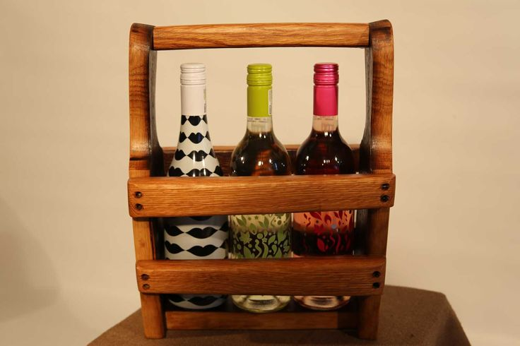 Crafted from genuine French oak wine barrel staves, this 3 bottle wine caddy is the perfect carrier for those special bottles of the Winelands' best.  Whilst the wine won't last, your caddy can always be refilled!  PLEASE NOTE: The wine bottles are just for illustration and not included with the caddy - sorry!  Dimensions:  H: 370mm  L: 300mm  W: 160mm  For more information or to order, phone/Whatsapp 0834712415 - or buy through our online store!