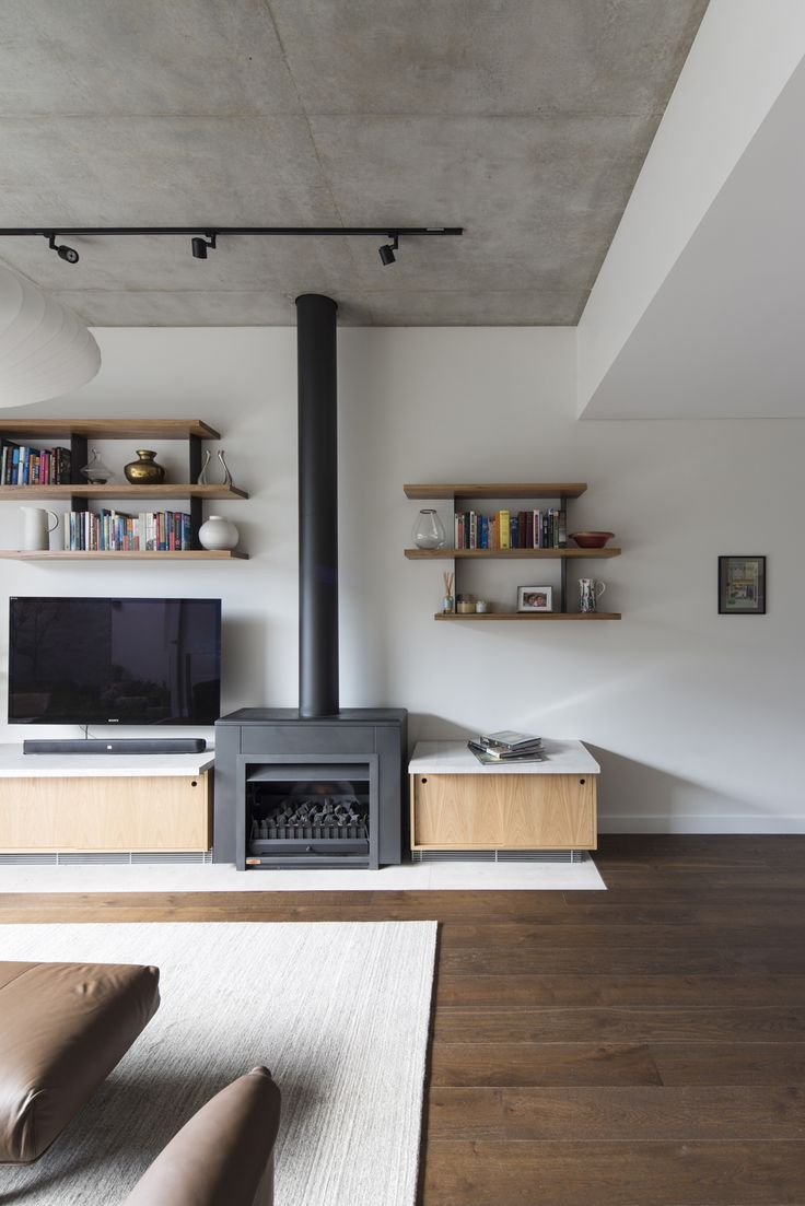 (c) Brett Boardman Timber Floorboards Fireplace Floating Shelves Concrete Ceiling