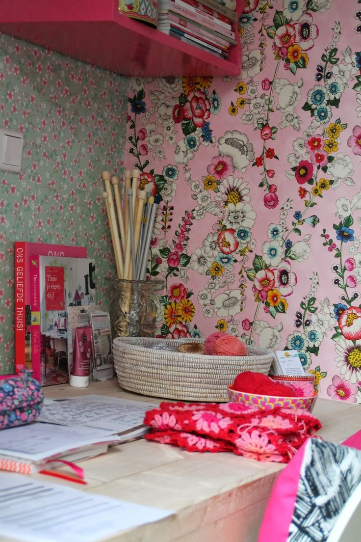 Colourful little nook for creating, love the retro-inspired wallpaper!