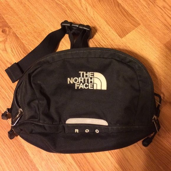 The North Face, black, Roo bag Belly bag, fanny pack, waist wallet, bum bag, butt pack, party pouch...what ever you call it, it's a timeless accessory that completes any wardrobe. Add this piece to your collection today! Purchased a number of years ago, it has been through the wringer. Easy to clean by throwing in the wash. No holes, a few dirt marks. Adjustable waist, lots of compartments and pockets for organization. Make an offer The North Face Bags Travel Bags