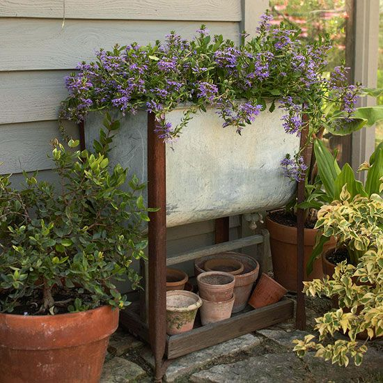 "Get creative with salvaged objects for curb appeal that lasts throughout the year! Whether you've got leftovers from a home project or you've been dumpster diving, odds and edds add much touted ""structure"" to any yard! http://www.bhg.com/gardening/landscaping-projects/landscape-basics/budget-landscaping/?socsrc=bhgpin050615salvagedplantcontainers&page=1"