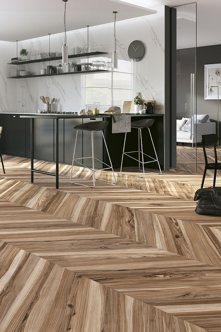 KORU is the new collection of porcelain stoneware strips by Mirage, a project that seeks to offer a reinterpretation of the types of wood of fruit trees. #miragetile #porcelaintiles #wood #chevron #kitchen #kitchendesign