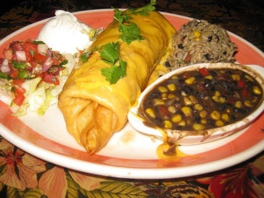 BAKED CHICKEN CHIMICHANGAS  Chi Chi's Copycat Recipe   2 1/2 cups chicken, cooked, shredded  2 tablespoons olive oil  1/2 cup onion, cho...