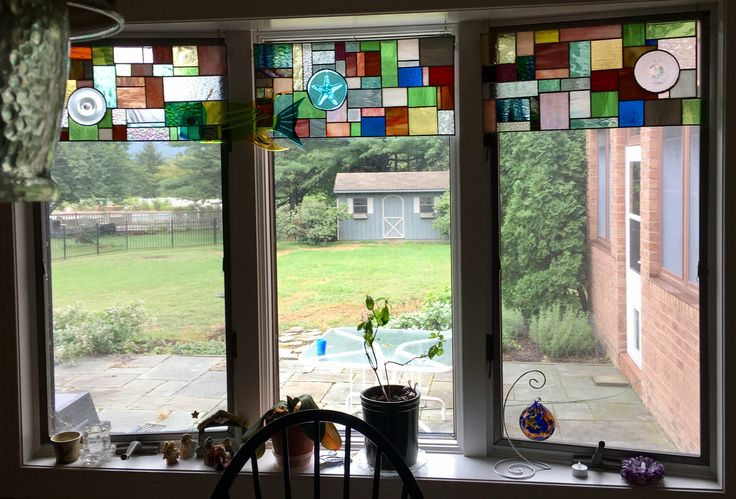 Stained glass window valence made from glass scraps and roundels.