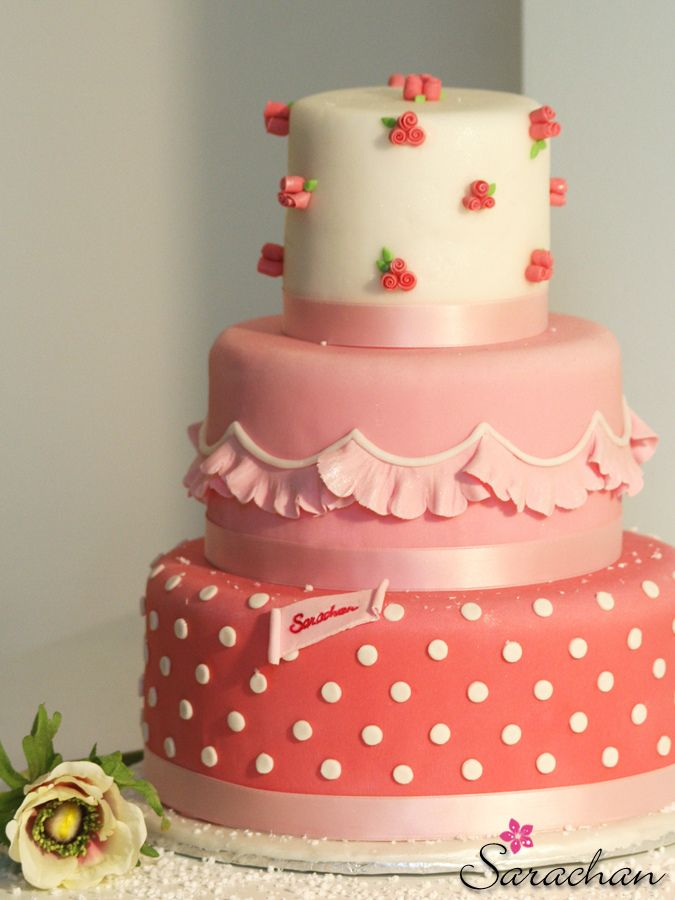 Such a pretty cake. Love the roses on the top tier and the ruffles on the 2nd tier.