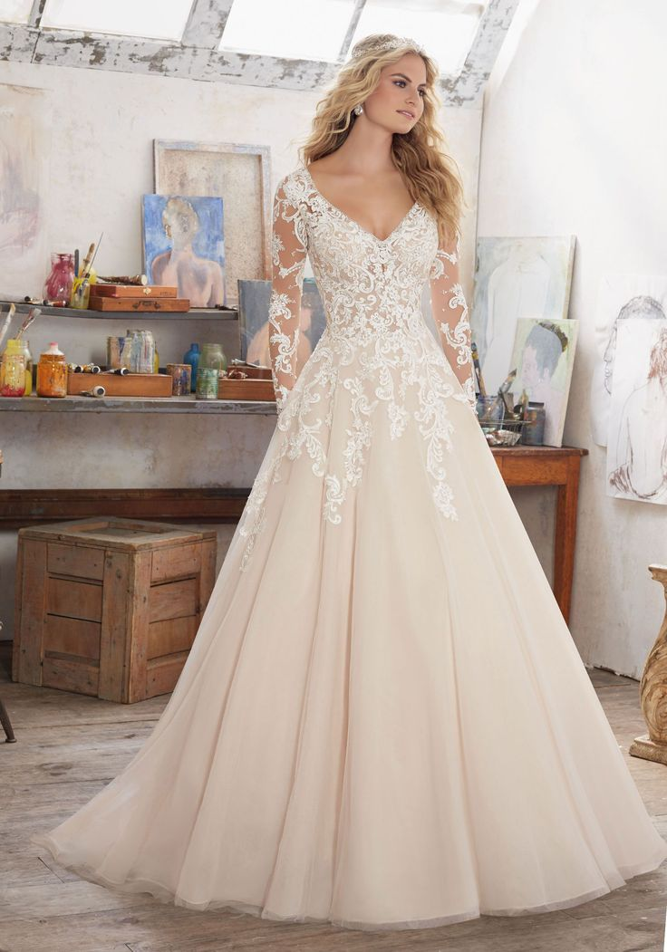 Morilee by Madeline Gardner 'Maira' 8110 | Long Sleeve Wedding Dress Featuring Delicate Crystal Beading on Bodice and Embroidered AppliquéŽs on Tulle. V-Neckline and Open Keyhole Back. Colors Available: White, Ivory, Ivory/Caramel. Shown in Ivory/Caramel.