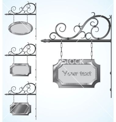 Wrought Iron sign holders - or hanging planters?  hmmmmm.....