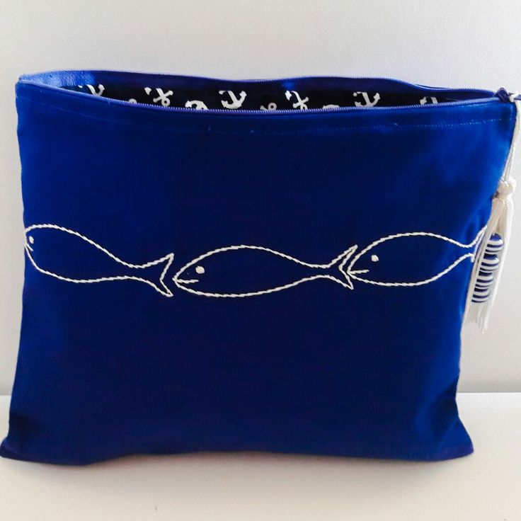 White fishes in blue water summer purse