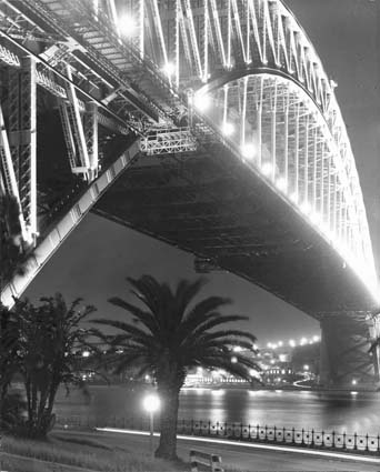 Sydney Harbour Bridge from south shore at night, 1968. Photographer: N. Hughes. NAA: B941, STATES/NEW SOUTH WALES/SYDNEYBRIDGES/2