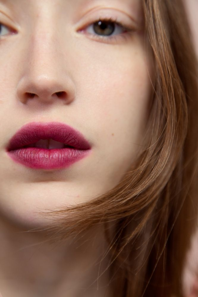 Elisa wears [Generation G Lipstick](https://glossier.com/