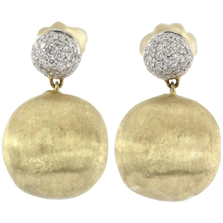 Marco Bicego 18K Gold & .48 Carat Diamond AFRICA Earrings. The earrings are in excellent estate condition and ready to wear. They still come with their original 18K gold earring backs. They are signed