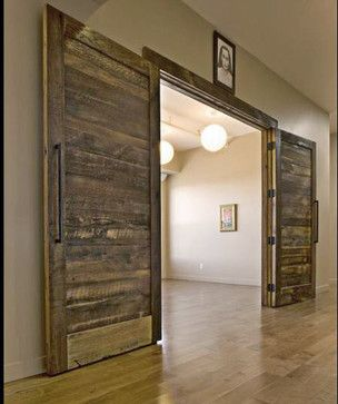 double oak doors made from reclaimed lumber make a beautiful entrance into this yoga studio