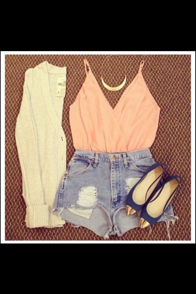 High waisted shorts paired with oversized sweater
