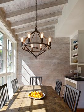 farmhouse table + reclaimed wood paneling + chandelier