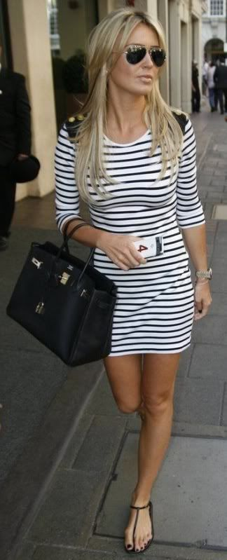 Flattering stripped dress with sandals and tote bag.