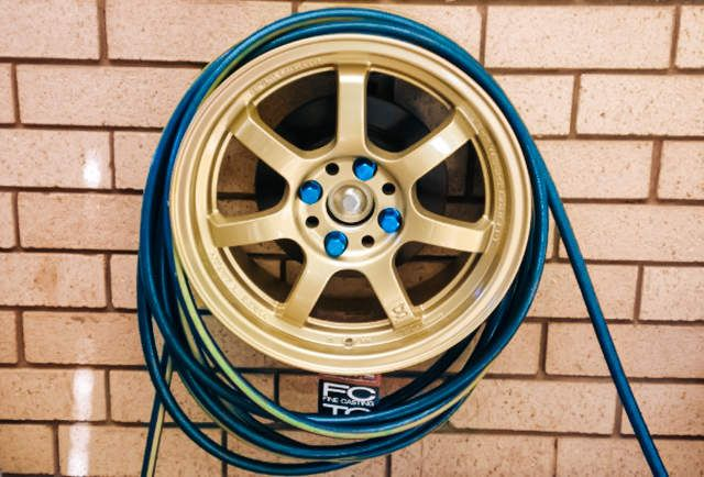 14 Brilliant Uses For Old Car Parts - gotta try this one, looks like a 'reel' hose reel! Shared by www.highroadorganizers.com