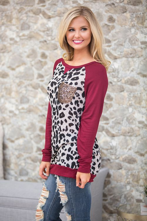 This beautiful blouse has some of our favorite trends this season, all rolled into one stunning look!