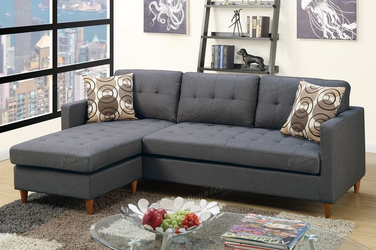 """Poundex Sectional Sofa F7094 $499  Description:  Prep your living space with this 2-piece reversible sectional stocked in a smooth linen-like finish and seating accent tufting. This modular piece is also supported with short pegged leg supports and two accent pillows. Available in black or chocolate.  Materials:  Particle Board Pine Wood Rubber Wood leg Blue grey Polyfiber Dimensions:  Reversible Sectional Sofa: 86"""" x 59"""" x 33""""H"""