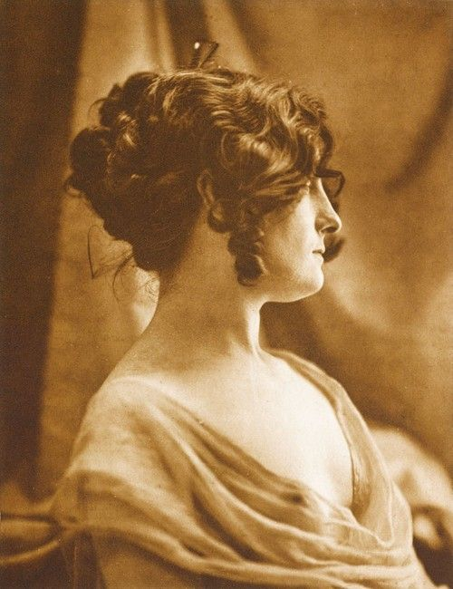 So good! Except for the loose curls in the face. (A young woman in profile, 1898. Photo by Maurice Bremard.)