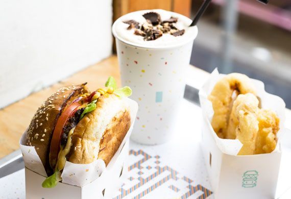 8Bit's burger with cheese, beer battered onion rings and peanut butter milkshake recipe - 9Kitchen