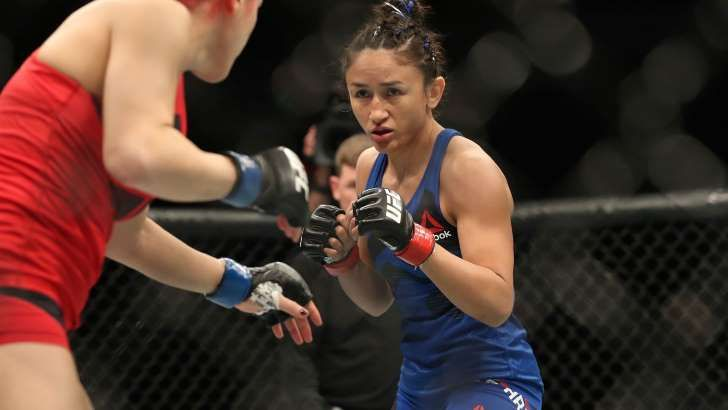 Watch Carla Esparza punch a fan in the face ... because he asked her to