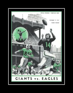 NY Giants vs Philadelphia Eagles 1957 Football Program Cover Art Poster.  This ready-to-frame wall art is printed to order on heavyweight semi-gloss photo paper. It is then inserted into a 100% archival safe, acid-free clear sleeve. Lastly, it is carefully packaged in a flat mailer to ensure safe delivery.  This football program cover artwork is printed to order on heavy weight gloss photo paper, inserted in a 100% archival safe, acid-free clear sleeve and a flat mailer; then carefully…