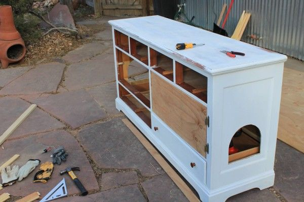 Repurpose an old dresser into a litter box hiding spot! And still have some storage