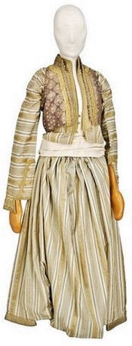 Matching components of woman's costume, worn by Jewish from Ioannina (northern Greece), late-Ottoman era, 19th century.  Striped cream silk jacket and 'shalvari' (baggy trousers),  with brocade waistcoat.  (© The Jewish Museum of Greece, Athens).