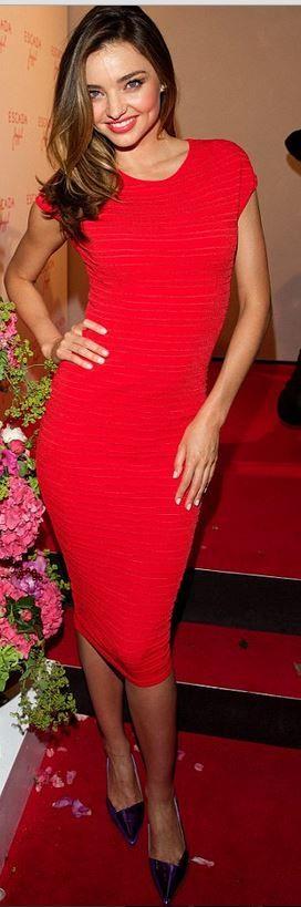 Who made Miranda Kerr's short sleeve red stripe dress and purple pumps?…