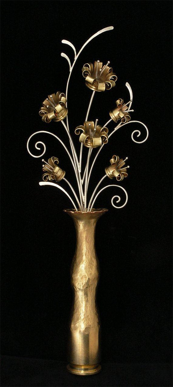 Bullet Flowers in a .50 BMG Vase. $650.00, via Etsy.