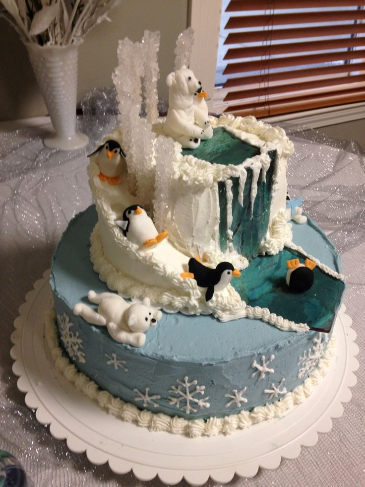 "The cake was a huge hit! Penguins and polar bears were made out of fondant and the ""ice"" was sugar.  So cute!"