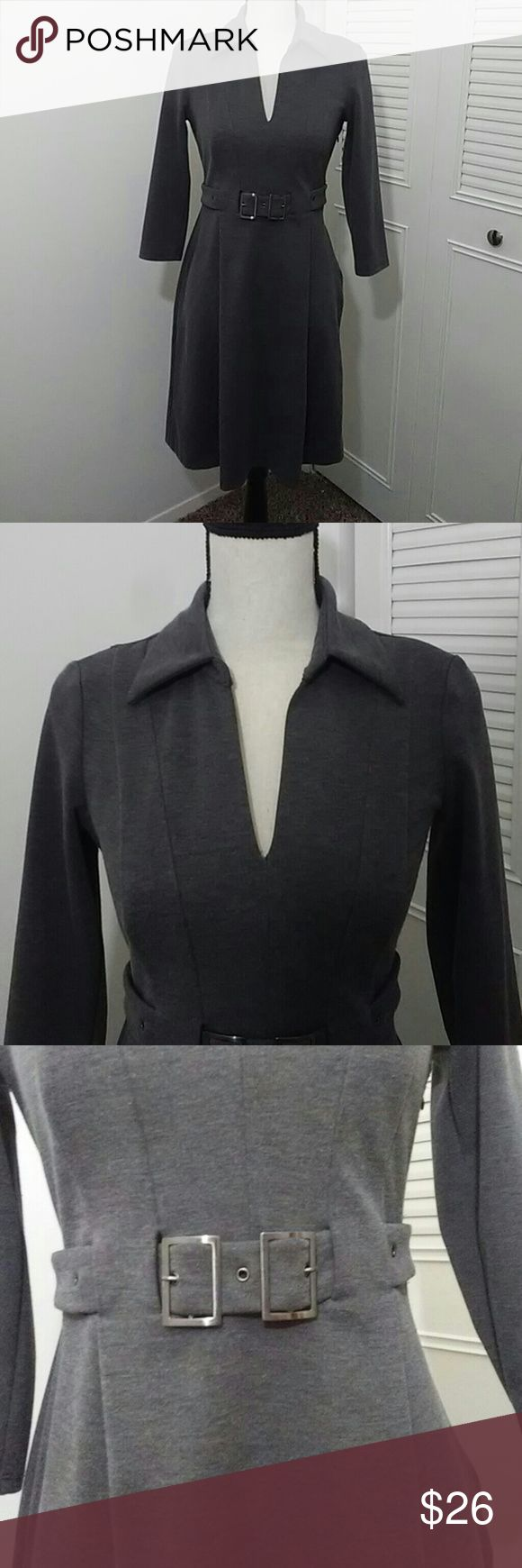 The Perfect Work Dress This grey dress by Nine West is the perfect blend of sultriness and sophistication. The thick fabric is warm and comfortable, and the cut of the dress hugs every curve. Features include a v neckline, built-in belt (nonadjustible) that is double belted, side zipper, 3/4 sleeves, and two large pleats in the front to allow for some skirt flair. Measurement (lying flat): bust 16.5, waist 14, hips 20, sleeves 17, length (from back) 36. Make me an offer! Nine West Dresses…