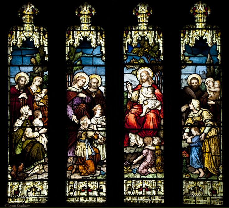 St. Michael's is one of the outstanding medieval churches in Scotland. Windows depict Jesus with little children, while angels watch above. St Michael's Parish Church in Linlithgow, Scotland.