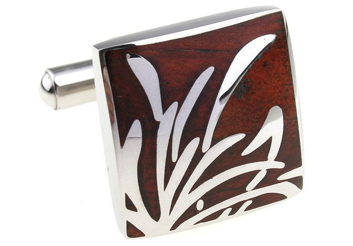 These premium cufflinks are one of our favourite designs. The classic simplicity of the stainless steel 'reeds' piercing the polished rosewood make them stylish and stunning. You want to see these in person and, when you do, you'll want to wear them and never take them off. Well, maybe not, but we know you will love them too. Wear them to the office, to dinner, to weddings, to a night out on the town, you will always look fabulous in these cufflinks.
