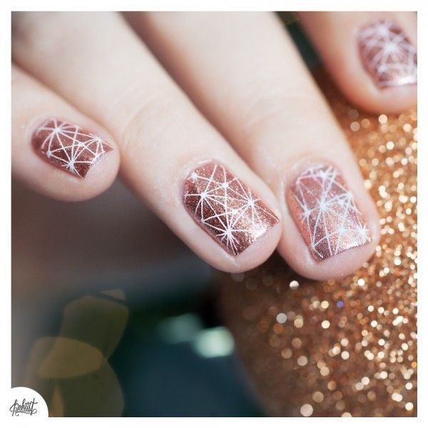 Metalic geometric nail design for the girl who needs her bling on on a daily.