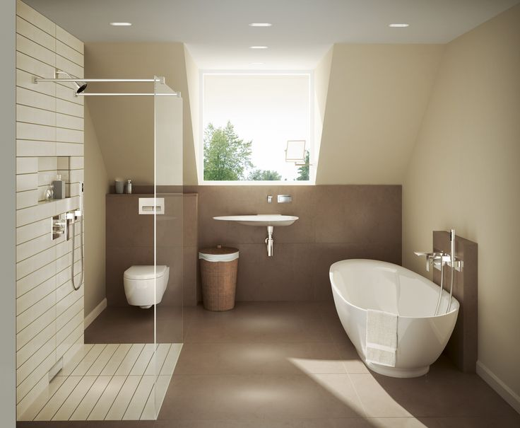 A Geberit in-wall toilet system provides extra space in this warm, inviting bathroom with plenty of natural light.